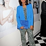 At an art gallery event in LA, Kerry topped her printed jumpsuit with a blue boyfriend blazer, then matched her jacket with a blue suede oversize clutch.