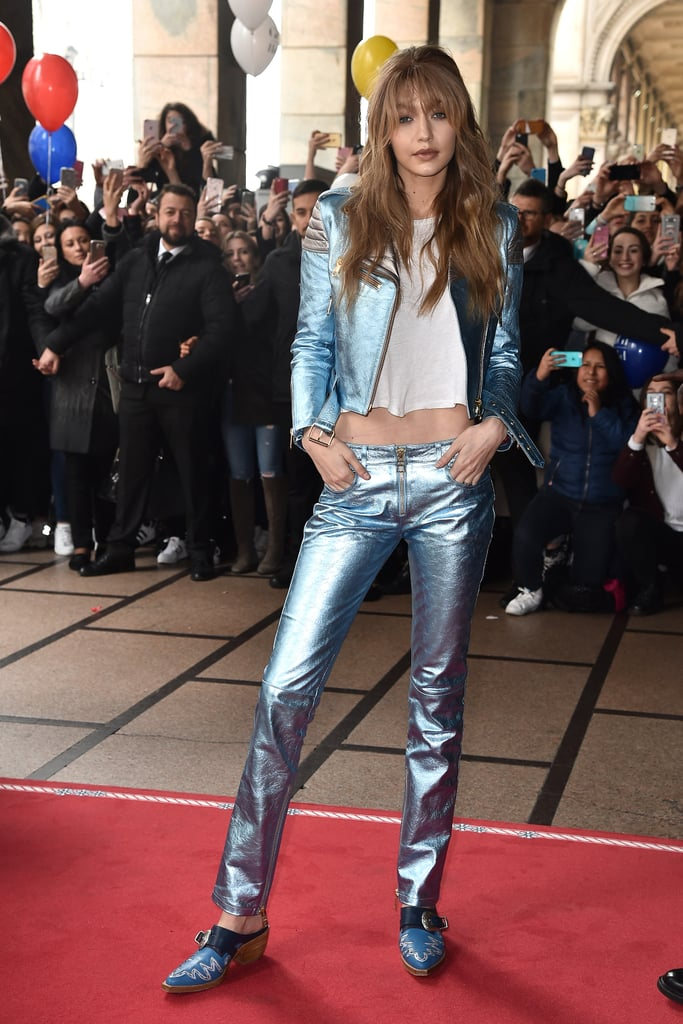 Gigi styled her flashy blue pair with a metallic moto coat to promote her Tommy Hilfiger x Gigi line in Milan.