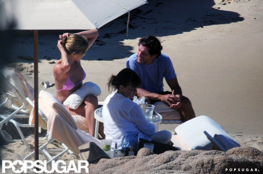 Jennifer Aniston pulled back her locks and chatted with a friend during a September 2008 trip to Cabo.