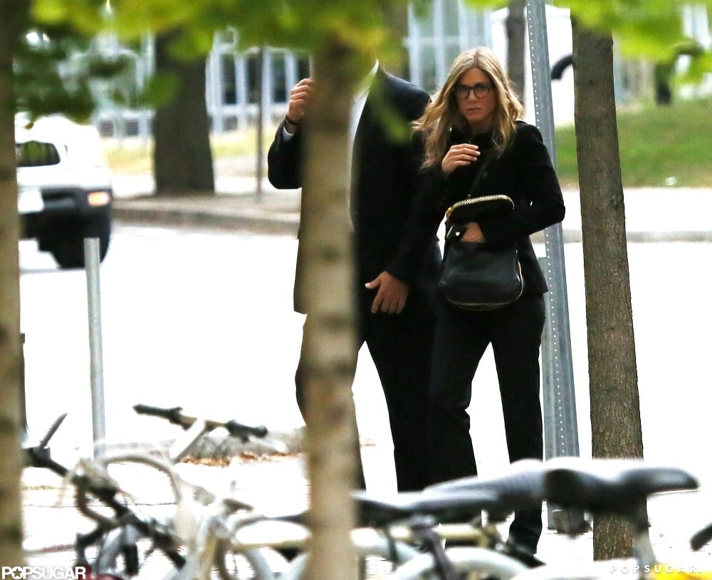 Jennifer Aniston walked in Boston with her hand tucked in her purse.