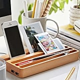 Keep your gadgets organized and charged in the Wood Charging Station ($50). It has two USB ports, so you can charge more than one device, and has other slots to store anything else you need.