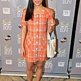 Wearing an orange plaid minidress at an event for her show Fresh Off the Boat in 2016.