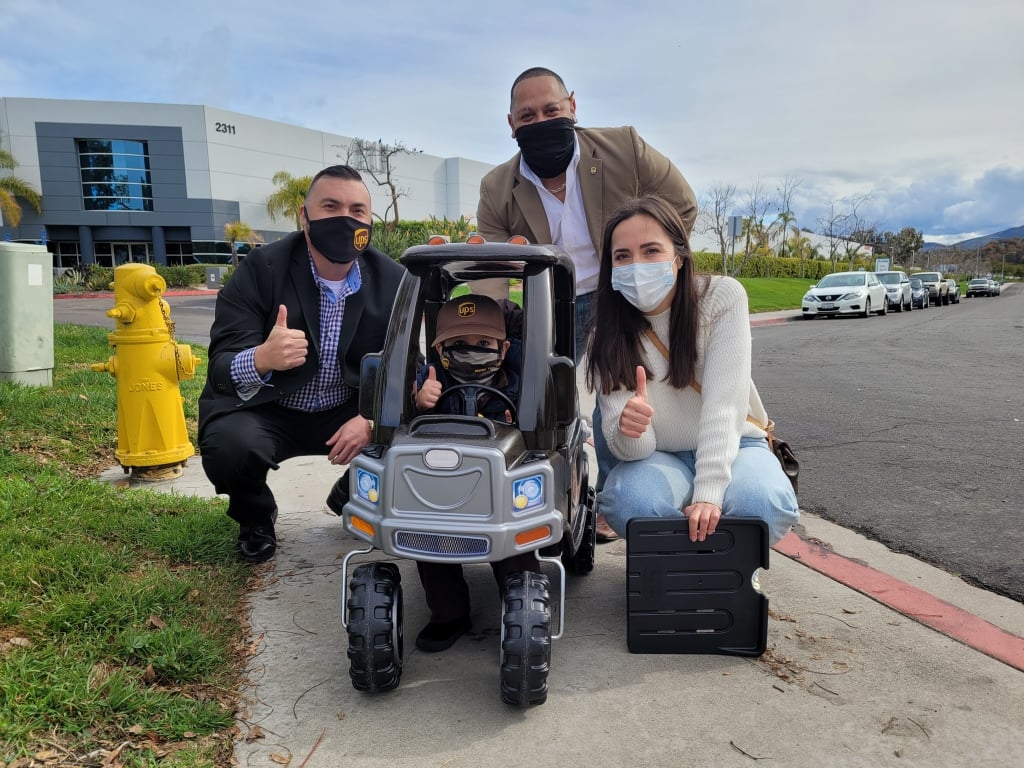 """Marco Elizondo, a 2-year-old from Chula Vista, CA, has been infatuated with UPS trucks ever since he and his mom, Clarissa Alcazar, moved close to a UPS hub last year. Although he was interested cars and planes at the time, there was something about the UPS trucks, specifically, that sparked his passion. After Clarissa and Marco made it a point to stop by the facility to wave to the drivers every day for seven months, some friendly employees decided to surprise Macro with his very own mini UPS truck. As expected, it truly made his day. """"I've been jogging with him almost every day since he was about 6 months old and once I noticed he was really into UPS, I decided to change our route up and run up to the hub to see if we could see a UPS truck close up,"""" Clarissa told POPSUGAR, noting that Marco was so interested in UPS trucks that her aunt even got him a mini uniform. """"Well, not only did we see one but we saw all the trucks as they headed out for the day. There were so many of them and he just thought it was the coolest thing. So ever since then, we've made jogging up to the UPS hub in the mornings part of our route."""" """"They even gave him some mini UPS package boxes he could throw in the truck when he plays with it."""" Mike Thornberry, the 24-year-old UPS driver behind the surprise, took the time to assemble the truck along with some of his teammates as a way of thanking Marco for brightening their day. """"Anytime we do something like that for a child it kind of warms your heart,"""" Mike told Good Morning America. Once Marco saw the gift, he was overwhelmed with gratitude. Moreover, Clarissa was incredibly moved by all the thought Mike and his team put into the details. """"I think initially he was in shock,"""" said Clarissa. """"He was so excited about it. He thinks it's the coolest thing. There isn't a day he doesn't play with his truck. They even gave him some mini UPS  boxes he could throw in the truck when he plays with it. They thought of EVERYTHING! The vehicle number 5218 i"""