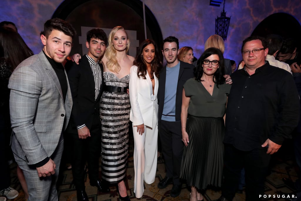 Sophie Turner was surrounded by loved ones as she attended the Dark Phoenix premiere in LA on Tuesday. In addition to sharing a few cute moments with her X-Men family, the 23-year-old actress also had husband Joe Jonas by her side. The newlyweds were matching in stripes as they posed for the cameras. Joe even had a proud husband moment as he snapped videos of Sophie greeting fans and working the red carpet. Sophie got even more support from her Jonas family as she posed with Kevin and his wife, Danielle, Danielle's brother Mike Deleasa, Nick, and her mother- and father-in-law, Denise and Paul.  The Jonas family has been in full force lately as the Jonas Brothers prep for the release of their album Happiness Begins. On Monday, Kevin, Joe, and Nick were joined by their wives as they attended the premiere of their documentary, Chasing Happiness. Joe also had his brothers by his side as he celebrated his bachelor party in Ibiza, Spain. Though Sophie and Joe already tied the knot in May, they still plan on having a wedding in France this Summer.  Related: It's Clear That Joe Jonas and Sophie Turner Make Each Other Incredibly Happy