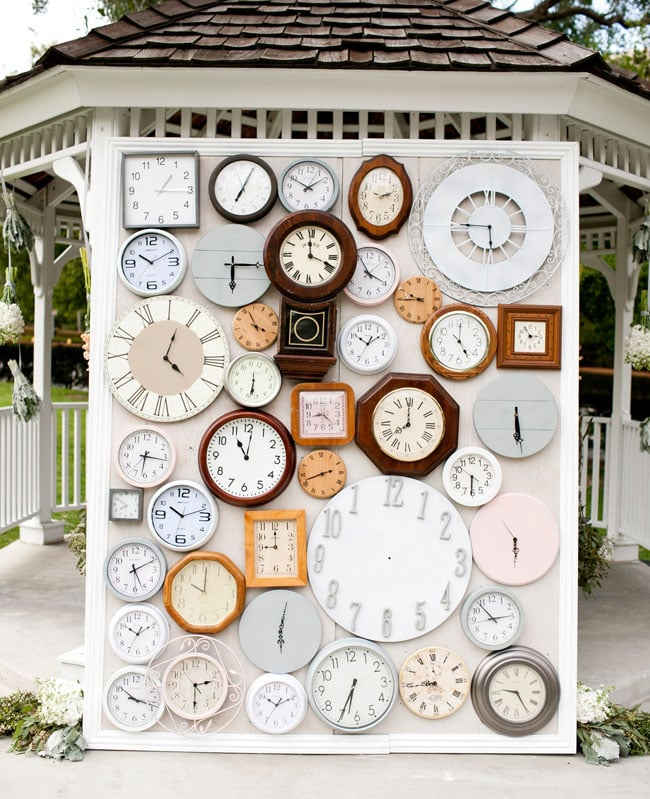 For a fun, whimsical twist, try creating a unique backdrop with found objects or a specific item that means something to you as a couple. Photo by Focus Photography via Green Wedding Shoes