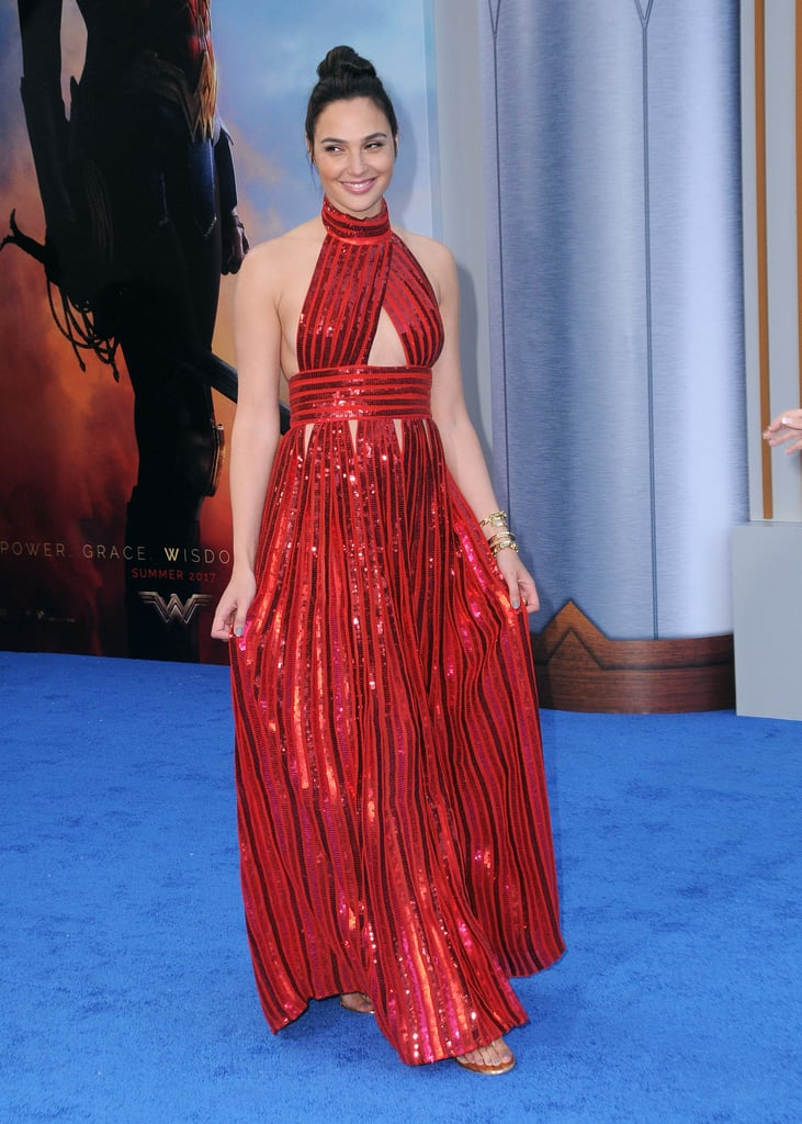 """For some, the mere thought of wearing flats with a dress could evoke some major insecurities, but Gal Gadot is basically saying f*ck that and wearing flats to even the fanciest red carpet events. On Thursday, May 25, Gal stepped out for the Wonder Woman premiere in Hollywood wearing a stunning red sequined Givenchy gown and a pair of $50 gold-studded sandals from Aldo.   Not only is she a superhero on the big screen, but she's also becoming something of a superhero in the fashion world, too. In fact, Gal has been wearing flats for the majority of her press tour for the movie, and her reason for doing so is perfect. When the mom of two was asked about her shoe choice, she spoke for every single heel-wearing human: """"It's more comfortable! Yeah,"""" she explained.  .@GalGadot has a very simple reason for wearing flats instead of heels to the #WonderWoman premiere. pic.twitter.com/P6ytSnjOIu — Variety (@Variety) May 26, 2017  Keep reading to see more photos of Gal rocking flats throughout her press tour for Wonder Woman, and let her inspire you to ditch heels the next time you go out."""