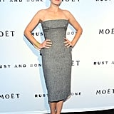 Marion Cotillard looked svelte in a grey strapless Christian Dior Fall 2012 Couture dress. We adore her futuristic hairdo and the pop of brightness via her blue pumps.