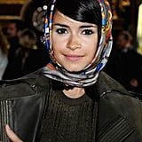 The quickest way to add glamour to your beauty look? Throw a scarf stylishly over your hair like Miroslava Duma.