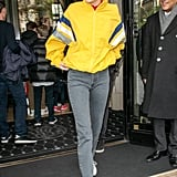In April, Kendall was spotted in Paris wearing a sunshine-yellow jacket from Balenciaga's Spring 2018 menswear line. She paired it with grey Yeezy mom jeans, white Adidas sneakers, and sunglasses.
