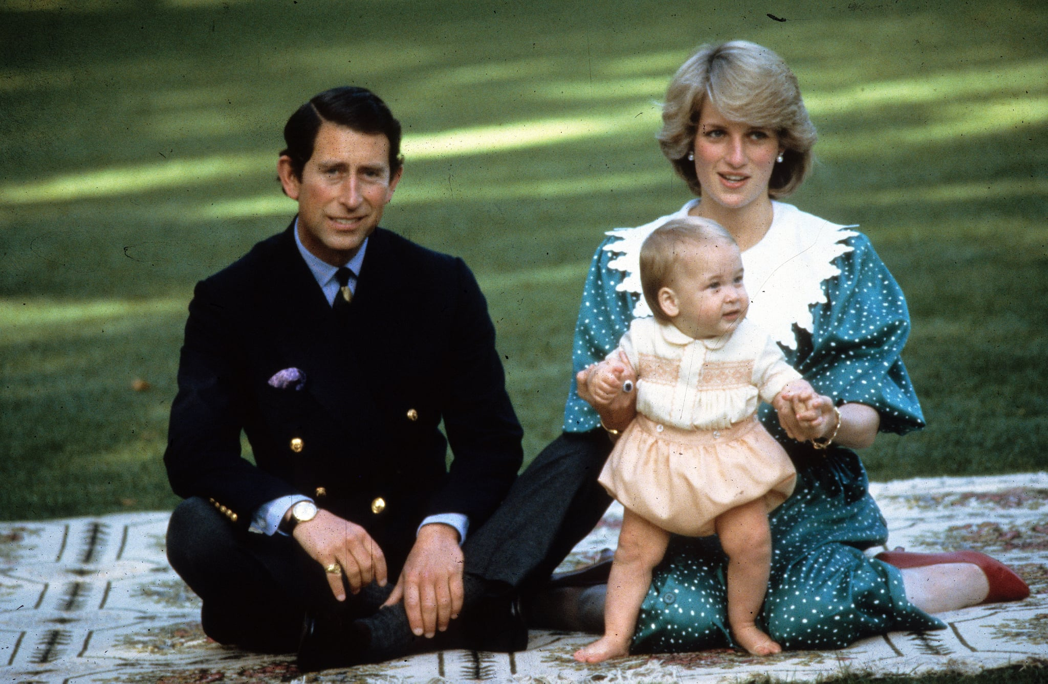 AUCKLAND, NEW ZEALAND - APRIL 18:  Princess Diana, Princess of Wales and Prince Charles, Prince of Wales play with their baby son Prince William in the gardens of Government House on April 18, 1983 in Auckland, New Zealand. (Photo by Anwar Hussein/Getty Images)