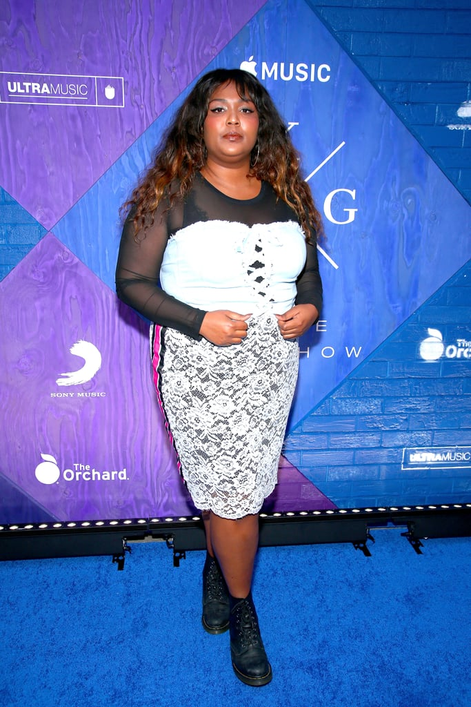 While Lizzo clearly loves to incorporate colour into her wardrobe, she's also not afraid to layer her clothes, mixing and matching different textures and patterns to create '90s chic looks like this denim corset top over a sheer blouse paired with a floral print skirt.