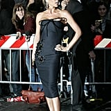 Victoria in an embellished bodycon dress and fascinator at Katie Holmes and Tom Cruise's wedding in 2006.