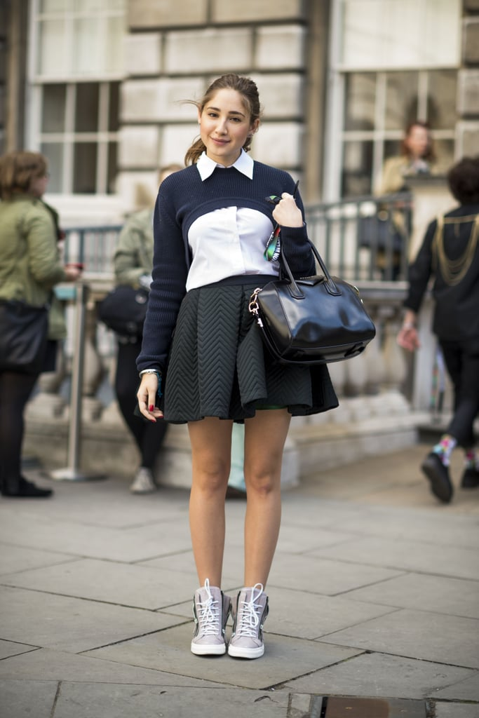 Pep up a Fall skirt and sweater combo with a pair of sporty kicks. These high-tops are just as practical as Fall ankle boots but lend a little on-trend, athletic appeal. Source: Adam Katz Sinding
