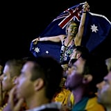 A fan waved her flag while watching the game between Australia and Chile.