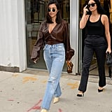 She paired it with a brown blouse, straight-leg jeans, and snake-print boots while shopping in Soho in June 2018.