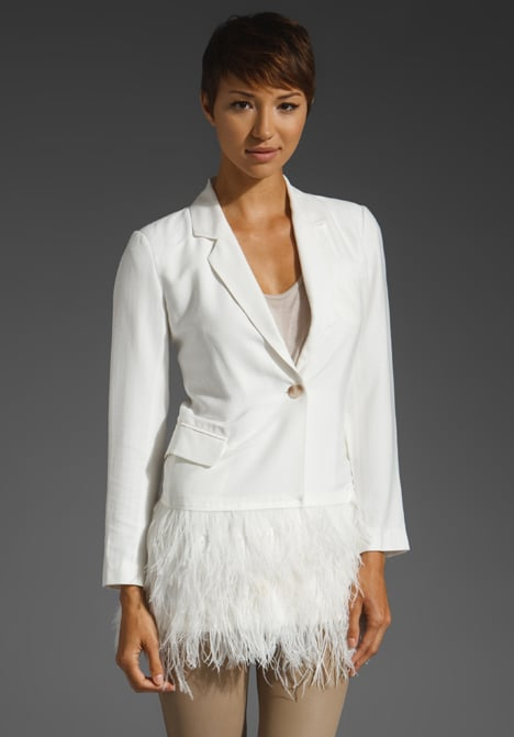 Put a glamorous spin on your work look by throwing this feathered blazer on over a pencil skirt, or layer it with a cocktail dress for evening.  Elizabeth and James Drapey Feather James Jacket ($665)
