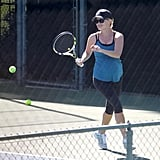 Reese Witherspoon ran for the ball while playing tennis with a friend.