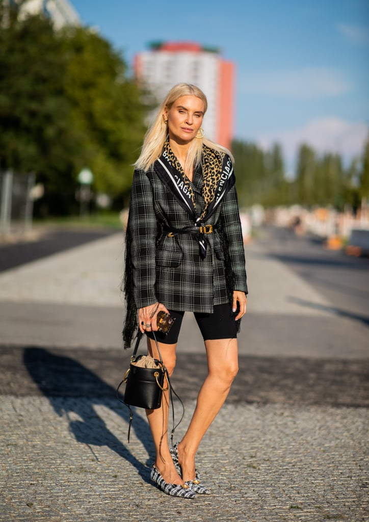 A plaid blazer really ties together casual pieces like biker shorts.