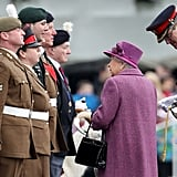 The queen looks up to members of The Royal Welsh.