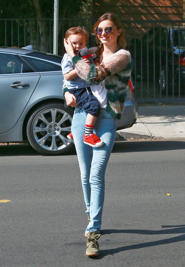 Miranda Kerr smiled while holding Flynn Bloom.