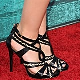 A pair of tribal-inspired Tabitha Simmons sandals finished Emma's look with cool-girl edge.