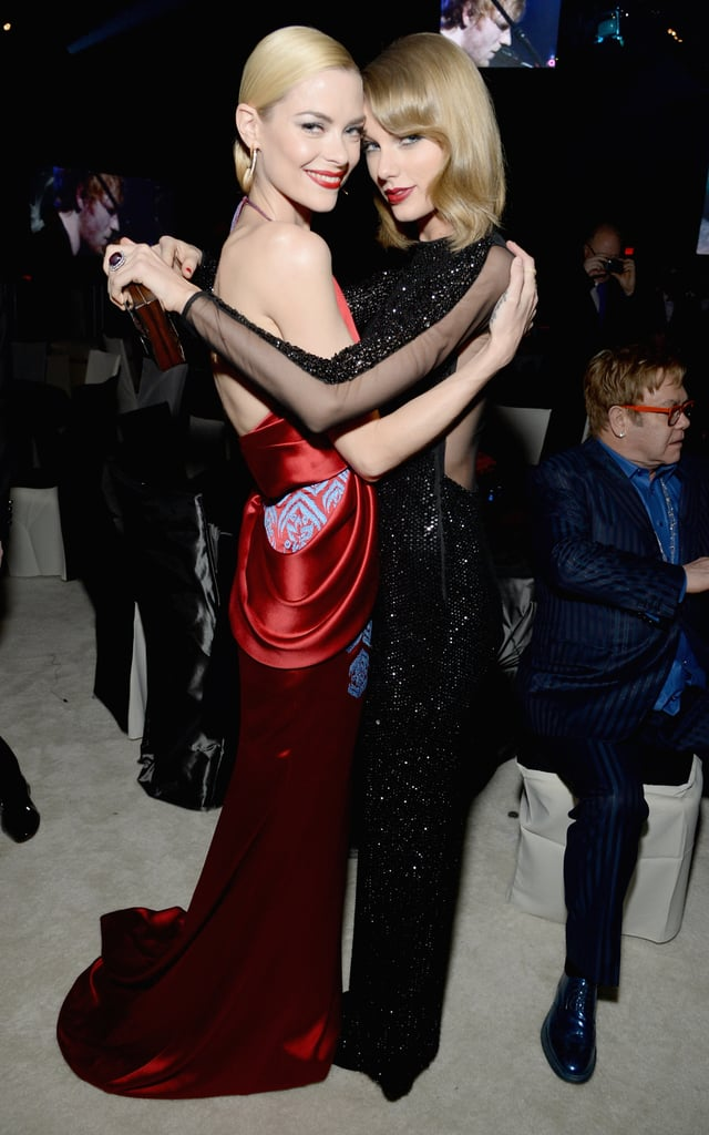 Taylor Swift and Jaime King embraced inside the Elton John viewing event.