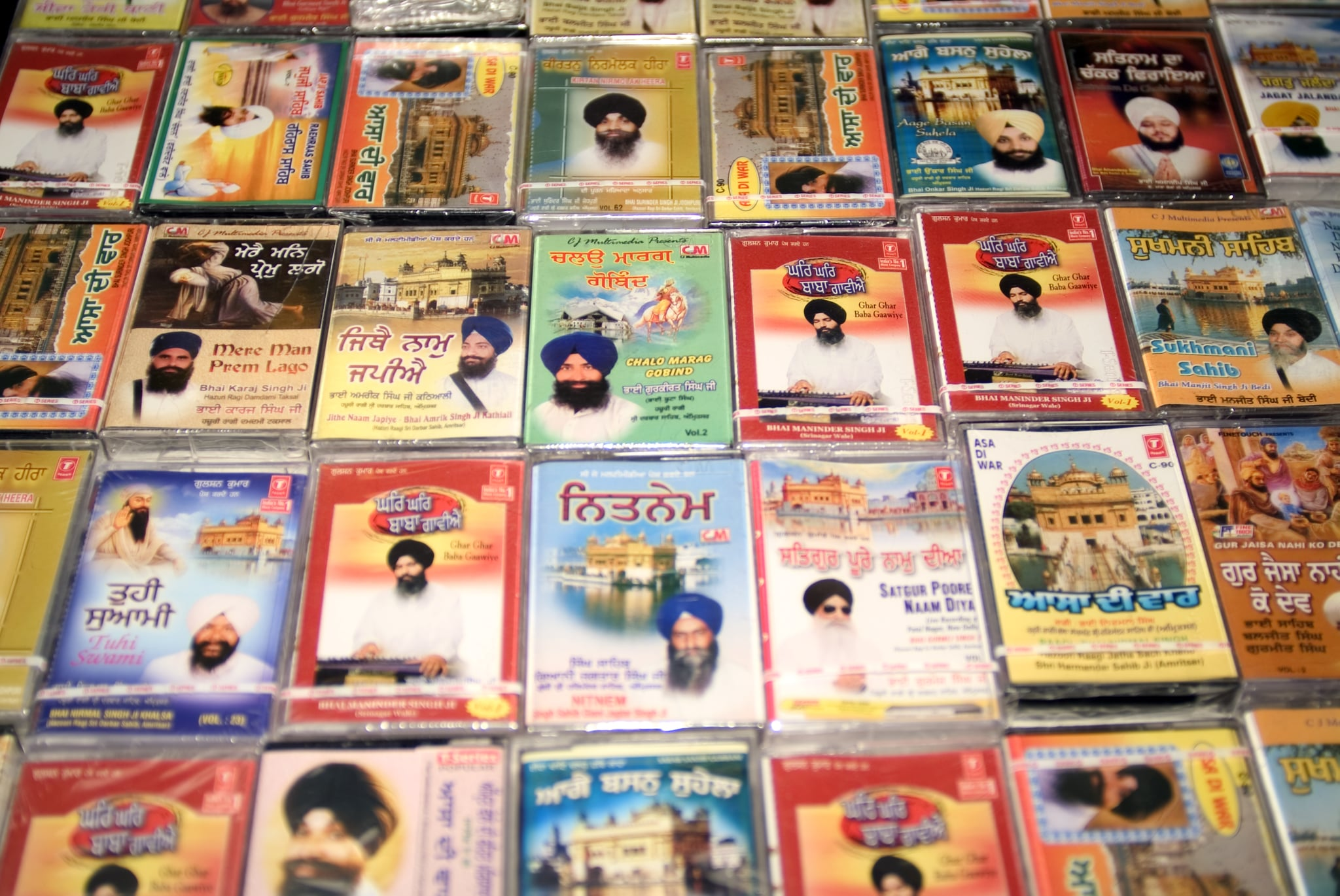 Punjabi music cassette tapes on sale in Sikh temple or Gurdwara Sri Guru Singh Sabha Hounslow UK. (Photo by: Photofusion/Universal Images Group via Getty Images)