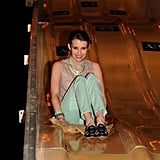 Emma Roberts looked stylish in mint-green pants and printed Tory Burch loafers while taking a ride down the slide at the A|X Armani Exchange Neon Carnival at Coachella. Photo courtesy of Seth Browarnik/WorldRedEye.com