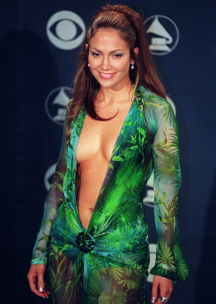 "Jennifer Lopez recently recounted the story behind one of the most famous red carpet moments of all time. After relaunching her YouTube channel, the singer and actress kicked off a new ""Moments of Fashion"" series, and, to no surprise, the first episode is all about her revealing palm-print Versace dress at the 2000 Grammys. The most fascinating thing we learned? The look almost didn't happen.  Around the time of the award show, Jennifer had been busy shooting The Wedding Planner, and she had really been cutting it close — as in, she still didn't have a dress selected until the day of the Grammys. Of the few dresses available, Jennifer's stylist, Andrea Lieberman, wasn't too keen on the Versace dress because it had already been worn by other celebrities, including Amber Valletta, Geri Halliwell, and Donatella Versace herself.  Despite her stylist's advice, Jennifer knew the Versace dress was the one. Her next obstacle, however, would be keeping the dress in place. ""The only concern was whether or not my boobs were gonna pop out on stage — or anywhere along the way,"" Jennifer said. Thanks to double-sided tape and toupee tape, that never happened. She added, ""There was never any danger of that. I was so securely stuck into that thing.""  ""One dress can change the trajectory of how people dress."" Once she hit the red carpet, Jennifer was taken aback by the response. ""It was a frenzy, in a way that it's not usually. There was an extra kinetic energy there,"" she said. Jennifer went on to explain how the red carpet moment is actually credited with inspiring the establishment of Google Images. Reflecting on its lasting impact, Jennifer said, ""It just goes to show you the power of fashion, and the power of those type of moments. I know people try to make it frivolous at times, but what those things do is they give people an inspiration. It puts a beautiful moment out into the world. It changes the style."" She added, ""One dress can change the trajectory of how people dress for the next 10 years."" Before ending the video blog, Jennifer also took a moment to pay tribute to Versace designer Luigi Massi, who died after suffering a heart attack on April 2. Through tears, Jennifer explained how she had been working with Luigi to create her look for the forthcoming Met Gala. ""Your talent and your love will never be forgotten,"" she said.       Related:                                                                                                           Jennifer Lopez Wore a Green Number That May Have Just Outdone Her Famous Versace Dress"