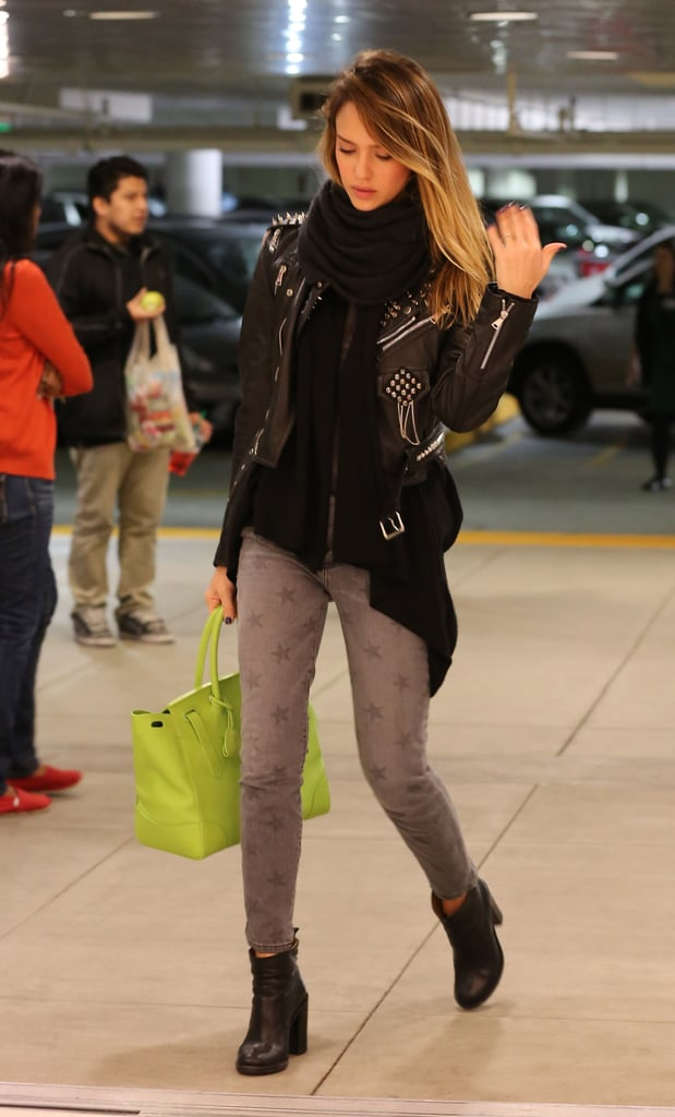 Jessica contrasted her gray star-print Current/Elliott jeans and lime green tote with a studded Simone leather jacket and chunky ankle boots while shopping in LA.