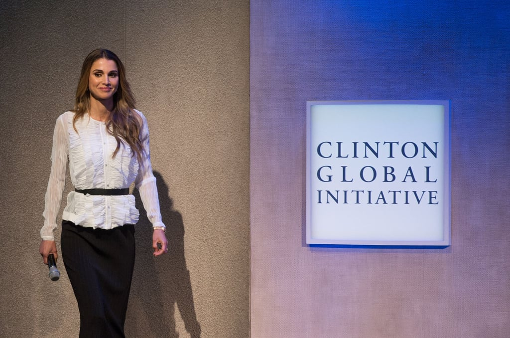Somehow the royals have all mastered the art of power dressing, including Queen Rania of Jordan. As one of the key panel speakers at the Clinton Global Initiative, Queen Rania knew her outfit had to be modest yet retain elements of her personal style. She choose a crinkled ruffle blouse and a knee-length black skirt, a simple outfit she could easily move in on stage. Add a pair of black heels and she could have called her look complete, except this is Queen Rania we're talking about. She decided to take it one step further and wore a black belt to highlight her waist and add structure to her outfit. It was this easy, power-woman styling hack that clinched the deal and took her ensemble to the next level. Read on to see how Queen Rania styled her belt and then shop some similar pieces to re-create your own  power-woman look at work.