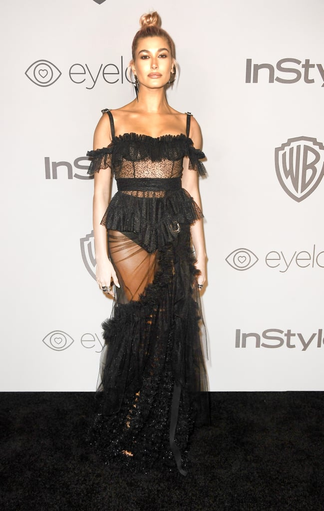 Hailey kicked off the year at a Golden Globes afterparty in January 2018 wearing this completely sheer, ruffled Dsquared2 number from the Spring 2018 line.