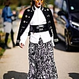 Ladylike with a twist is some of Olivia's best work — this time, she updated a maxi skirt with combat boots, a military jacket, and a wide leather belt.