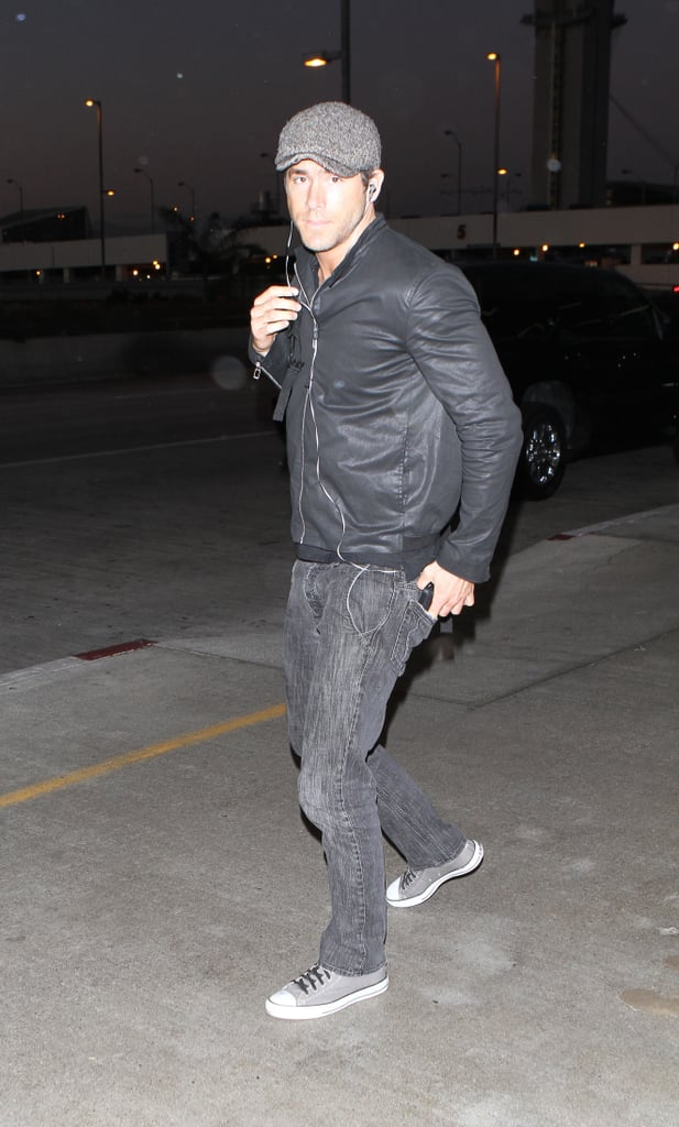 Ryan Reynolds was in head-to-toe shades of gray and black as he arrived at LAX to catch a flight out of town yesterday. After a short time off in the wake of Green Lantern, Ryan is launching right into his next promotional tour for The Change-Up. Ryan and Jason Bateman made an appearance at the ESPYs last week, and we'll be seeing a lot more of their handsome faces together ahead of the movie's Aug. 5 release. Ryan's love life is also back in the headlines with rumors that he's seeing Charlize Theron and spending time with his ex-wife Scarlett Johansson as well. Still, he's officially riding solo and was looking hot on his motorcycle in LA over the weekend.