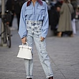 Tuck a boxy zip-up into mom jeans and finish with your favorite boots