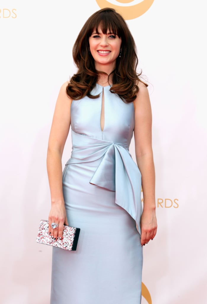 Zooey Deschanel smiled big on the Emmy Awards red carpet.