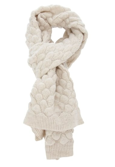 The ultimate of Winter-white scarves, this ivory Mm6 By Maison Martin Margiela Textured Knit Scarf ($279) would warm us up while looking impossibly chic.