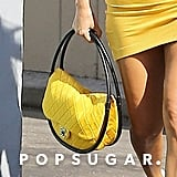 Kourtney Kardashian Yellow Reformation Dress and Chanel Bag
