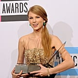 Taylor Swift smiled at the American Music Awards.