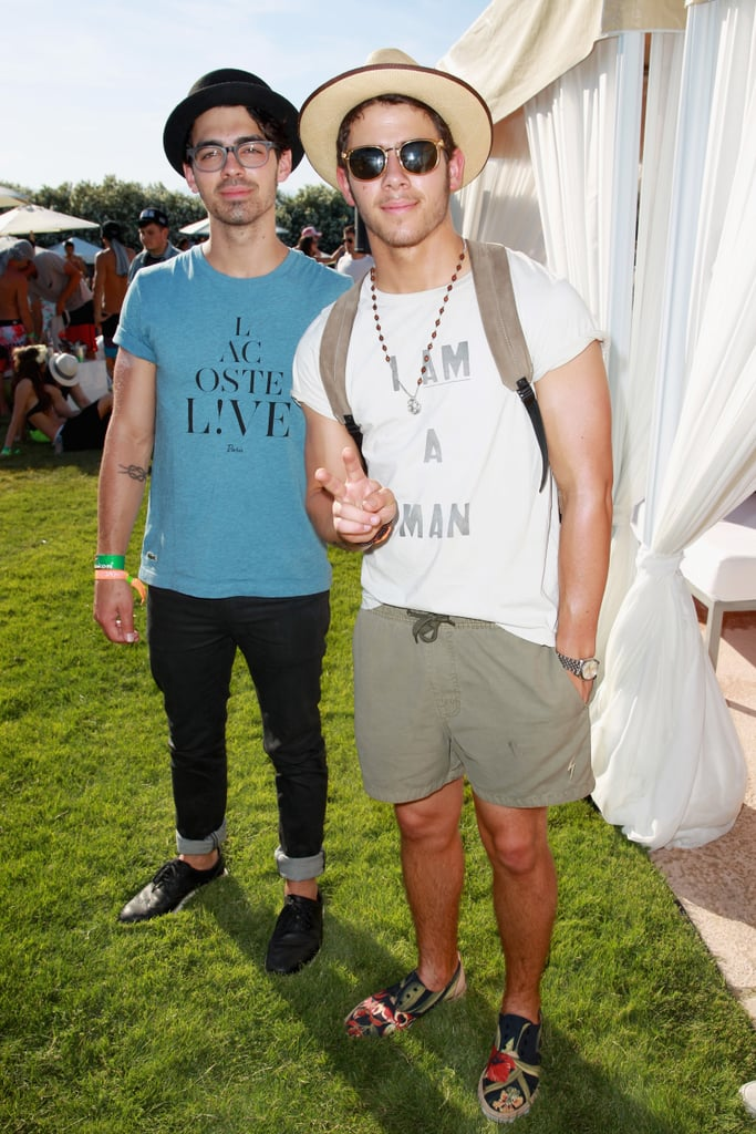 Joe Jonas and Nick Jonas kept cool in hats and shades.