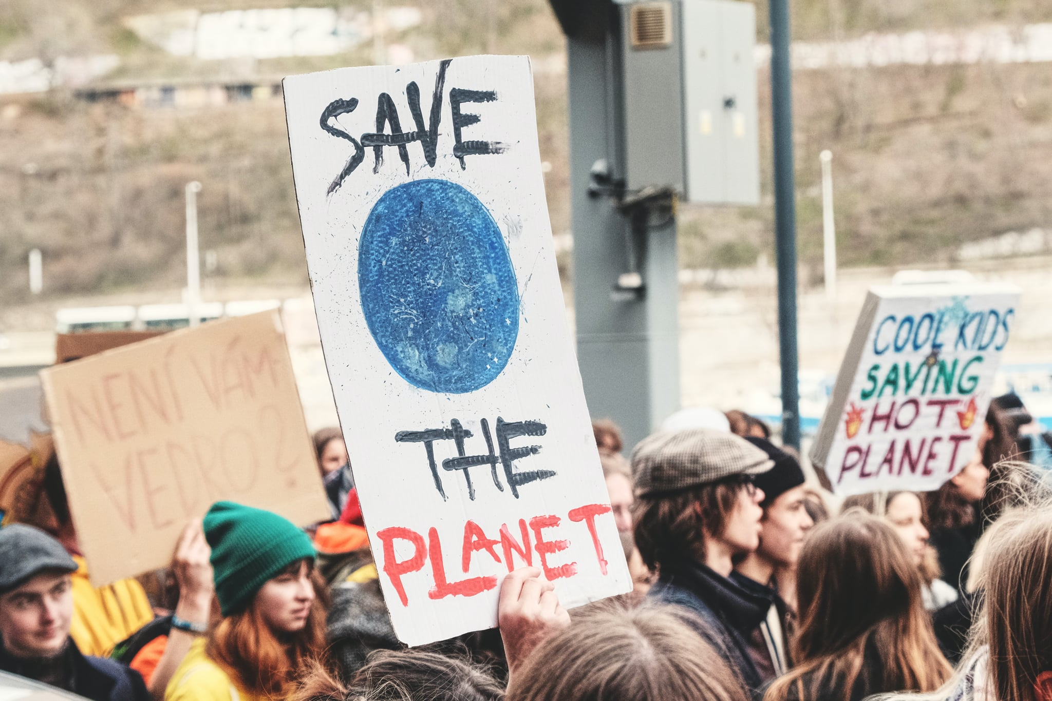 Pexels/Tomas Ryant https://www.pexels.com/photo/save-the-planet-signage-2852737/