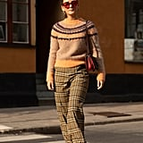 Styling a sweater and plaid pants with a white pair of Havaianas.