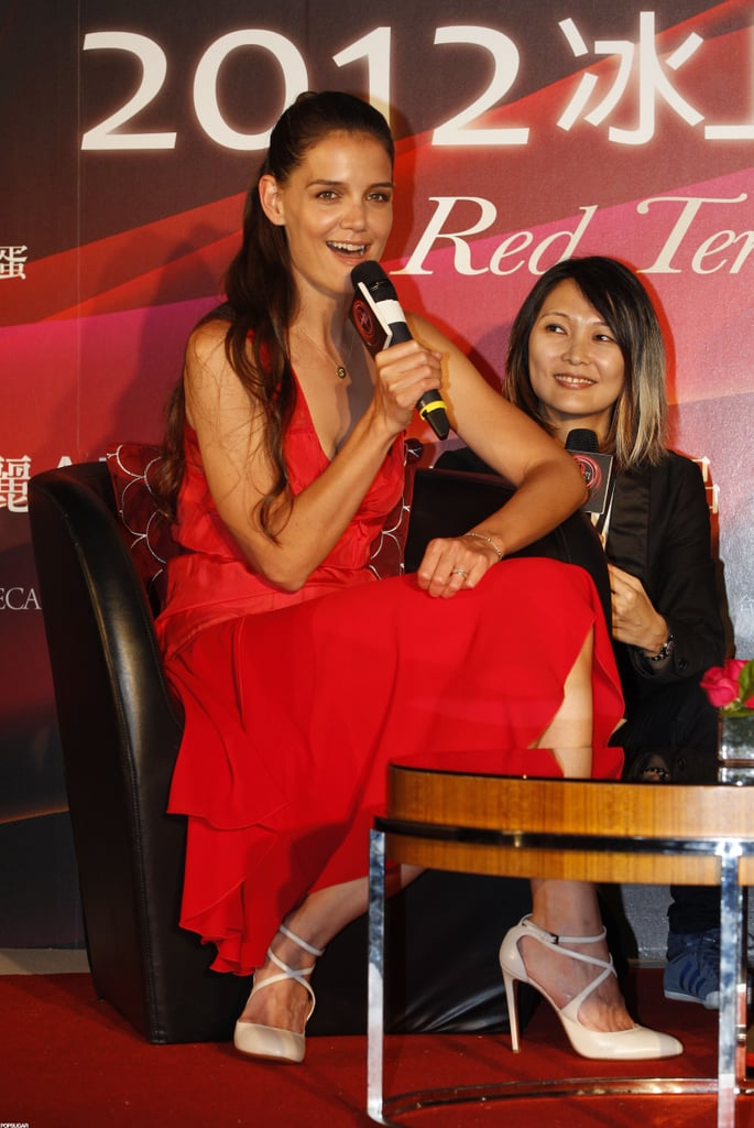 Katie Holmes spoke to an audience during a press conference in Taipei today. She wore a red Holmes & Yang dress while promoting Artistry on Ice, a skating event that will take place on Sunday. Katie's overseas trip comes after weeks of bouncing around the East Coast. She and Suri have been calling Kent, CT, where Katie is filming the untitled big-screen version of Anton Chekhov's The Seagull, their home lately, though they've also popped up in NYC. Meanwhile, Tom Cruise has been busy filming Oblivion in Louisiana as he also gears up for the June 15 opening of Rock of Ages — check out hot Rock of Ages pictures to get you excited for the release!