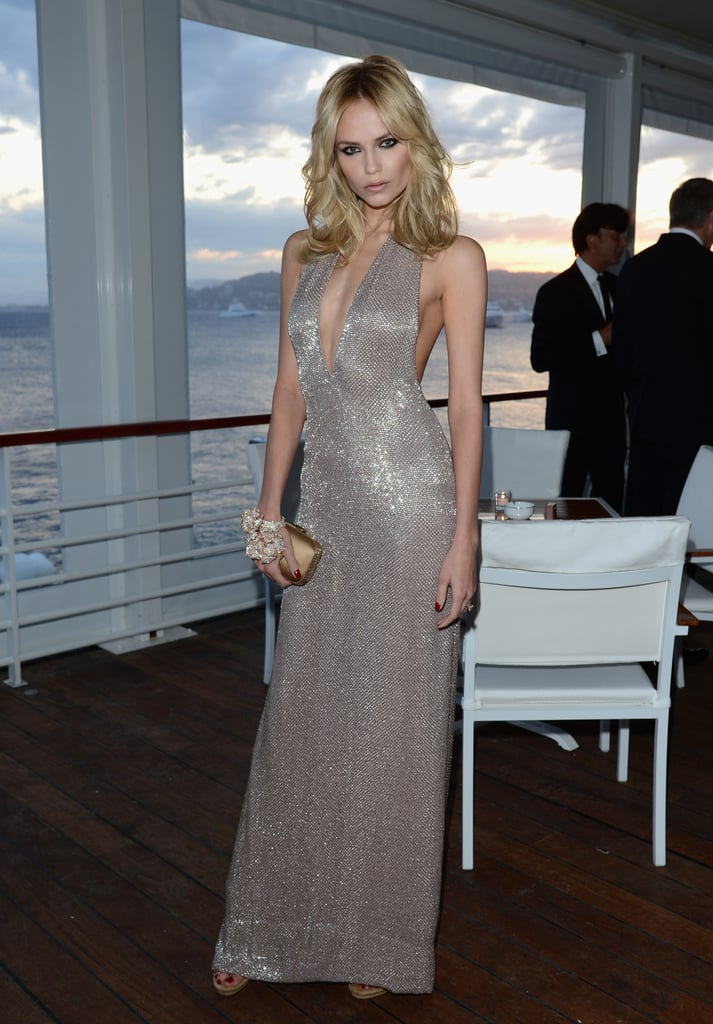 Natasha Poly worked a sexy metallic gown for Gucci's party.