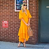 Carry It Wearing a Head-to-Toe Marigold Outfit