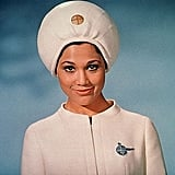 This Pan Am stewardess looks like the Amazing Kreskin. I wonder if she reads minds, too.