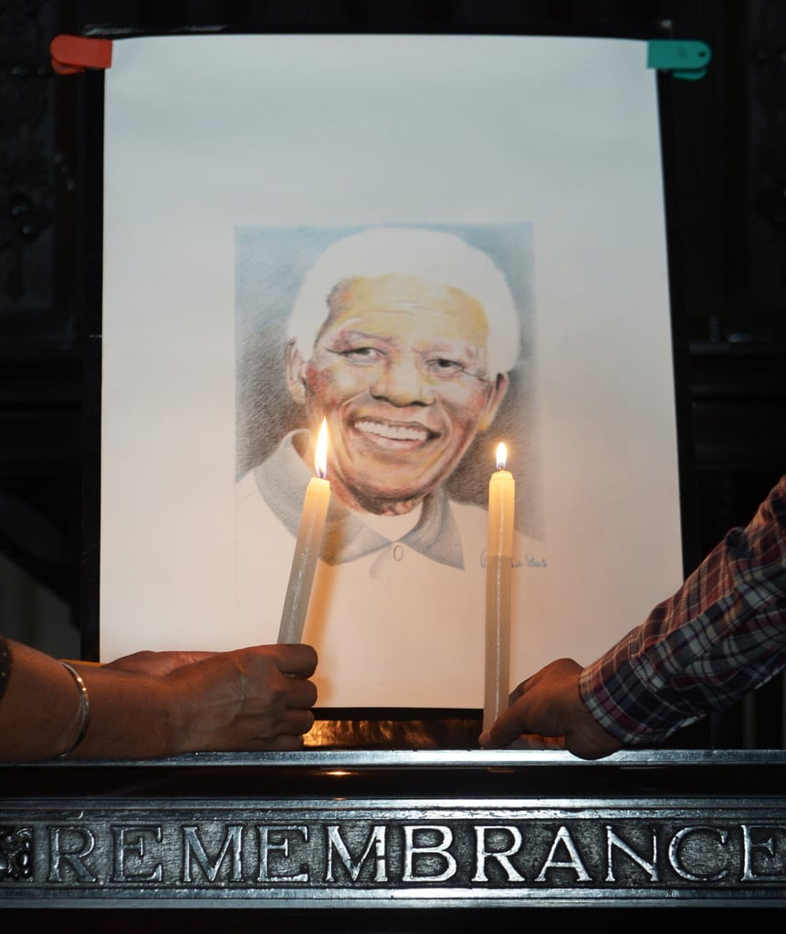 Candles were lit beside a photo of Nelson Mandela in India.