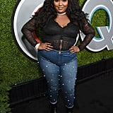 Of course Lizzo makes jeans look worthy of the red carpet, pairing the faux pearl-covered pants with a sexy sheer lace top.