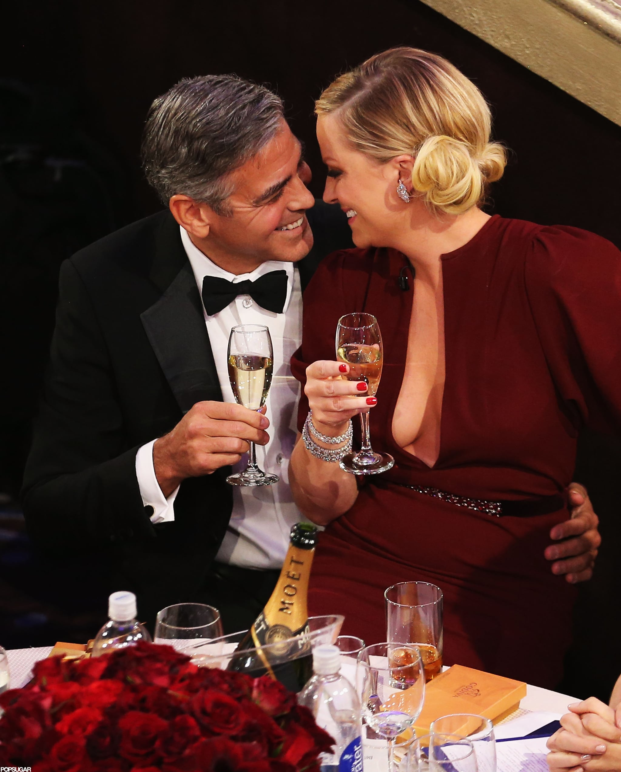 Host Amy Poehler and George Clooney shared a moment during the Golden Globes.