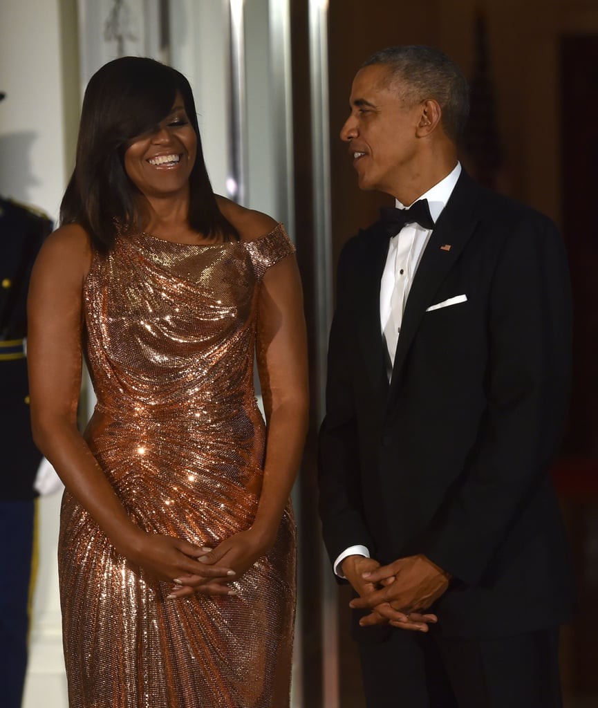 """Barack and Michelle Obama hosted their final state dinner at the White House on Tuesday night. Michelle stunned in a rose gold Atelier Versace gown as she and Barack welcomed Italian Prime Minister Matteo Renzi and his wife, Agnese Landini. The soiree included a menu prepared by celebrity chef Mario Batali and a guest list full of stars such as Jerry Seinfeld, Giorgio Armani, and Gwen Stefani.   Earlier in the day, Barack took the stage to speak to a crowd of students at Benjamin Banneker Academic High School in Washington DC and used the opportunity to poke fun at his teenage daughters, Malia and Sasha Obama. """"I know you may have been waiting here a while,"""" he said. """"Good thing you had your phones with you."""" He then impersonated the texting girls, saying in a funny voice, """"And then he said . . . 'Girl, I couldn't believe it,'"""" before showing off his master selfie-taking skills. While we'll definitely miss seeing Barack and Michelle, at least we have their cute moments to hold onto.      Related:                                                                                                           8 Photos That Show How Much the Obama Family Has Changed in 8 Years"""